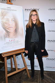 Jennifer Aniston donned a stylish fluted-hem coat by Alexander McQueen for the special screening of 'Cake.'