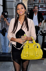 Alesha Dixon brightened up her ensemble with a mustard leather tote when she attended the Very.co.uk fashion show.