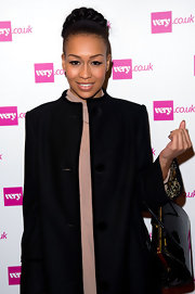Rebecca Ferguson donned a sleek braided bun while attending the Christmas Catwalk show in London, England.