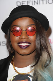 Misha B accessorized with a pair of round sunnies for a funky finish to her look during the Very.co.uk launch party.