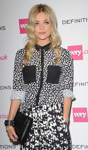 Laura Whitmore went for a mismatched look with this black-and-white print button-down and pants combo at the Very.co.uk launch party.