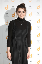 Maisie Williams layered a black turtleneck under a pinstriped jumpsuit for the 'daisie' launch party.