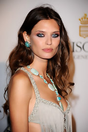 Bianca Balti made a bold statement in round turquoise earrings at the de Grisogono dinner at Cannes.