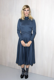 January Jones teamed her frock with strappy black platforms, also by Bottega Veneta.