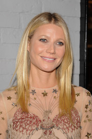 Gwyneth Paltrow wore her hair straight with a center part (as usual) at the Goop Mrkt grand opening.