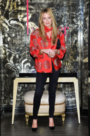 Cat Deeley teamed an Oriental silk blouse with sexy black skinny jeans for the harper by Harper's Bazaar event.