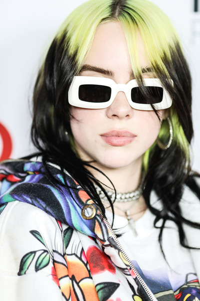 Billie Eilish went for cool styling with a pair of rectangular, thick-rimmed shades.
