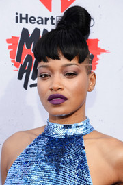 Keke Palmer's purple lipstick worked beautifully with her blue outfit.