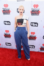 Iggy Azalea teamed her top with high-waisted blue pants, also by Off-White c/o Virgil Abloh.