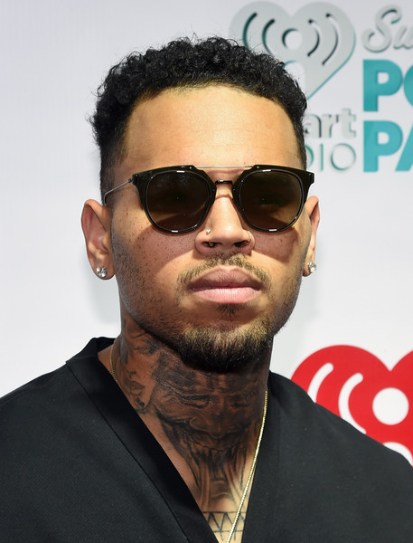 Chris Brown's sunnies feature brown lenses with black frames.