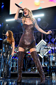 Taylor Swift performed at iHeartRadio's Z100 Jingle Ball 2019 wearing an oxblood sequined mini dress.