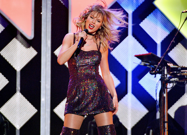 More Pics of Taylor Swift Sequin Dress (2 of 21) - Dresses & Skirts Lookbook - StyleBistro [iheartradio,capital one,taylor swift,performance,entertainment,music artist,singing,singer,performing arts,thigh,lady,pop music,stage,z100 jingle ball,new york city]