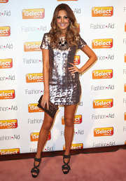 Laura Dundovic was all aglow at the iSelect Fashion + Aid in a fun and fab metallic silver mini dress.