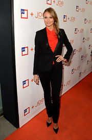 Stacy Keibler added a pop of color to her monochromatic look with a red button down.