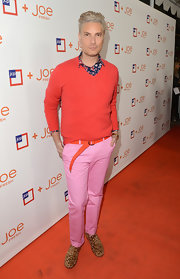 Cameron Silver opted for a classic red v-neck sweater to pair with his bubblegum pink pants.