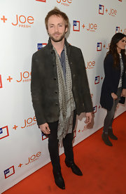 Paul McDonald topped off his casual look with a print scarf for an extra boho touch.