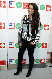 La La Anthony attended the jcpenney Holiday Giving Tour kickoff wearing a fitted black-and-white cardigan.