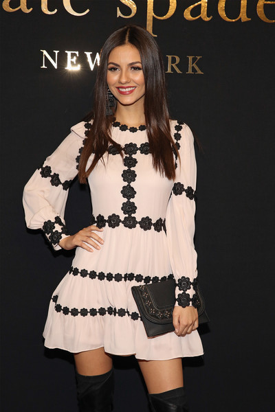 Victoria Justice was in the mood for florals when she wore this Kate Spade leather clutch and mini dress combo during the label's fashion presentation.