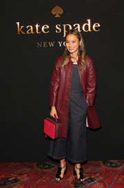 Jamie Chung hit the Kate Spade fashion presentation wearing a stylish burgundy leather coat.