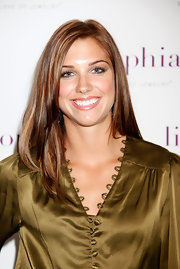 Alex Morgan showcased her flawless skin wearing her chestnut locks with sleek face-framing layers.