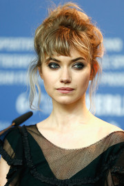 Imogen Poots sported a messy, teased updo at the Berlinale press conference for 'A Long Way Down.'