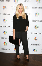 An oversized leather clutch rounded out Mollie King's all-black ensemble.