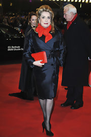 Catherine Deneuve showed her old-school Hollywood glam with a fitted evening coat at the 'On my Way' premiere in Berlin.