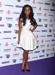 Ame chose a white frock with a full skirt and lace bodice for her look at the vInspired Awwards in London.