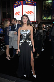 Nina Dobrev added extra sparkle with a beaded clutch by Jimmy Choo.