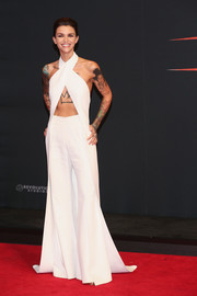 Ruby Rose flaunted her toned and tattooed arms and abs in a flowing white halter top by Balmain at the world premiere of 'xXx: Return of Xander Cage.'