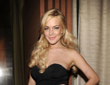 Lindsay Lohan Doesn't Expect Theft Charges, Parties with Giuseppe Zanotti