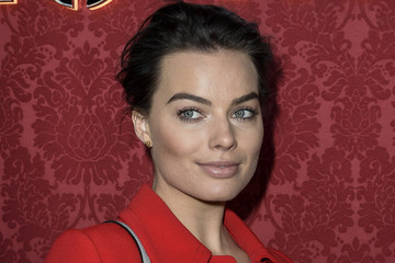 Margot Robbie's Bold Red Coat and Natural Glow