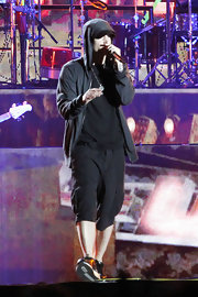 Eminem headlined at Coachella 2012 wearing a pair of black cargo shorts.