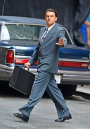 Wearing a double-breasted blue suit and carrying a briefcase, Leonardo DiCaprio looked very business-like on the set of 'The Wolf of Wall Street.'