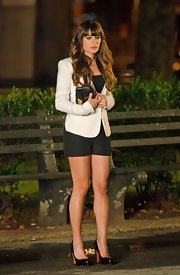 Lea Michele's chunky black platform pumps fit right in with the rest of her black-and-white tailored outfit.