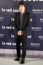 Jesse showed off his stylish side in a simple black suit which he completed with a relaxed plaid button up.