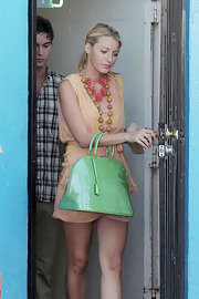 On the set of 'Gossip Girl,' Blake Lively infused her look with color with a lime green patent Vernis Alma tote.