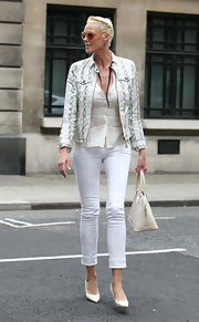 Brigitte Nielsen teamed her all white street wear with matching pointy leather pumps.