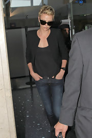 Charlize Theron is known for her classic style as she showed even while traveling when she wore a sleek black blazer over a tee.