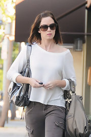 Emily Blunt looked relaxed in a slouchy striped top.