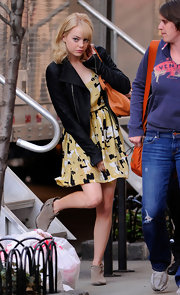 Emma Stone wore taupe suede ankle boots with a yellow print dress.