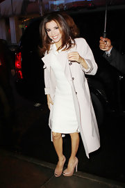 Eva Longoria gave her fitted white sheath a feminine vibe with a long blush coat with rolled sleeves.