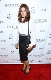Eva Mendes exuded classic sophistication in a black pencil skirt and a white blouse during the launch of her collection.