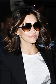 Gina Gershon arrived at the 'Wendy Williams Show' looking sassy with her feathered flip.