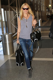 "Gwyneth Paltrow arrived at LAX toting Alice + Olivia's black leather ""Olivia"" bag."