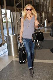 Gwyneth Paltrow kept it easy, breezy, and cool in these whiskered roll-cuff skinnies.