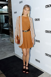 Isabel Lucas channeled Cleopatra at the ASOS launch in Sydney. The stylish model donned a beaded headpiece and burnt orange chiffon cocktail dress with a pleated skirt. Velvet flatforms and a draped kimono overlay were part of her eclectic ensemble.