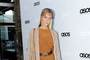 Actress Isabel Lucas in a beaded headpiece for the launch of Asos Australia at the Carriage Works in Sydney.