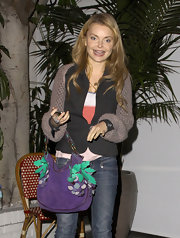 Izabella Miko added fun to her night wear with a purple grape motif purse.