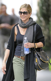 Jennifer Aniston styled her outfit with a gray scarf.
